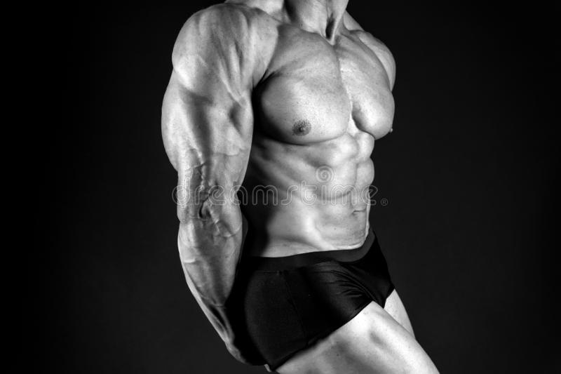 Strong muscles and power. male body. muscular macho man. diet and fitness. sport as healthy lifestyle. bodybuilder stock photography