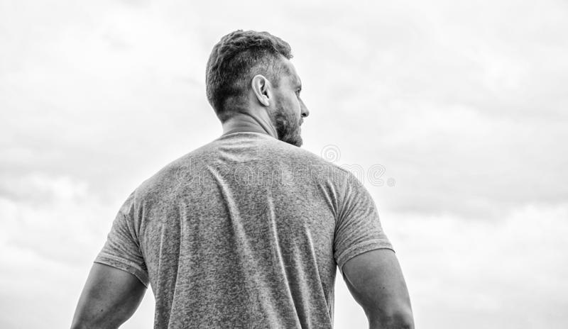 Strong muscular body feeling powerful rear view. Successful athlete. Victory and success. Champion winner. Future stock images