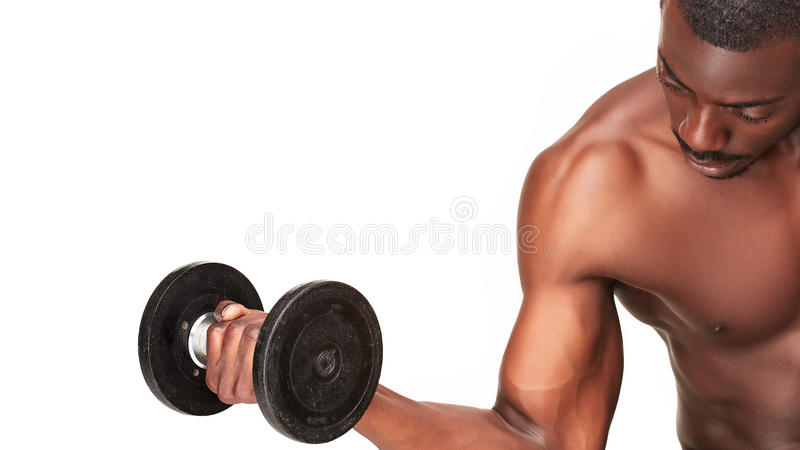 Strong and muscular guy with dumbbell isolated on stock image