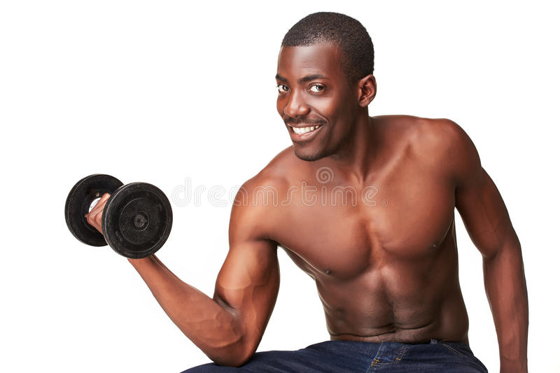 Strong and muscular guy with dumbbell isolated on royalty free stock images