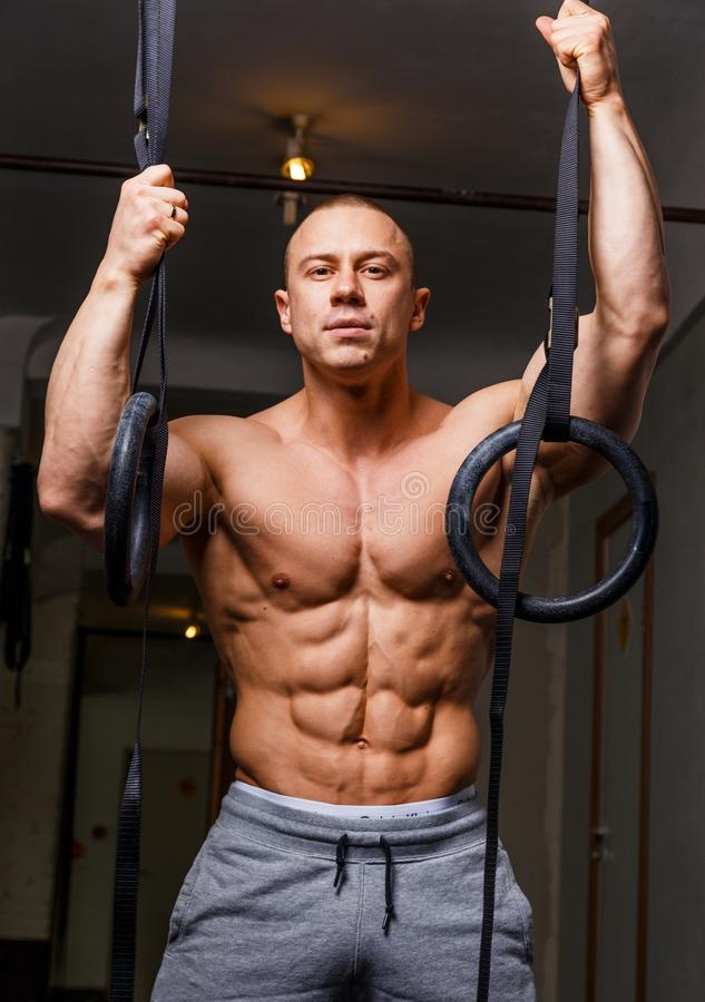 Strong muscular man. Bodybuilder poses and shows his body stock photography