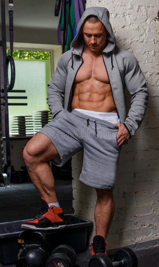 Strong muscular man. Bodybuilder poses and shows his muscles stock photography