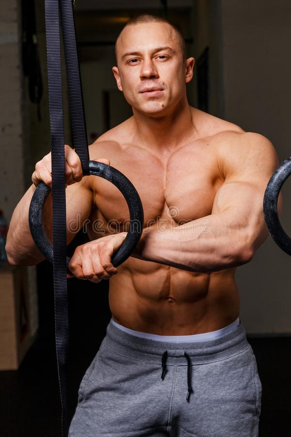 Strong muscular man. Bodybuilder poses and shows his abs stock photography