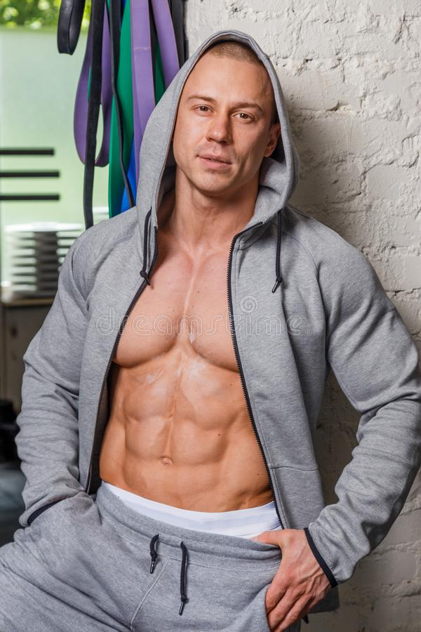 Strong muscular man. Bodybuilder poses and shows his body royalty free stock photos