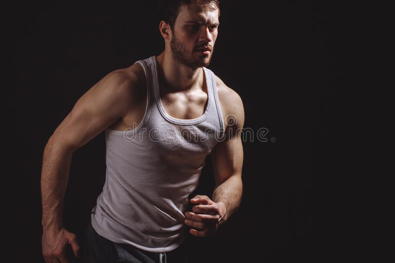 Strong passerby go in for heel and toe walking on the black background royalty free stock photo