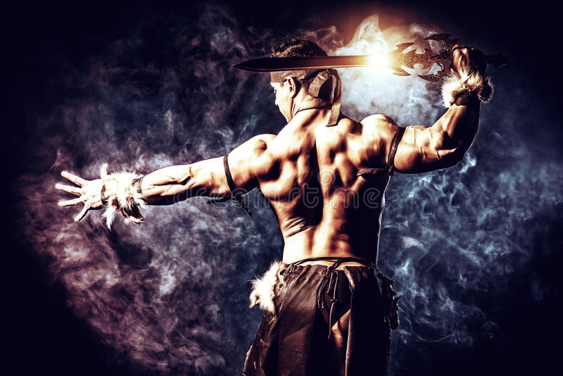 Strong. Portrait of a handsome muscular ancient warrior with a sword stock images
