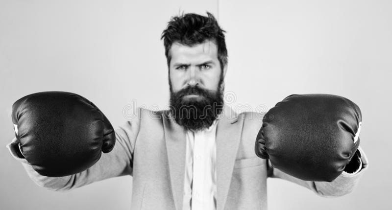 Strong and powerful. Bearded man in boxing stance. Fighting for success in sport and business. Businessman in formal. Wear and boxing gloves. Sport improves his stock photography