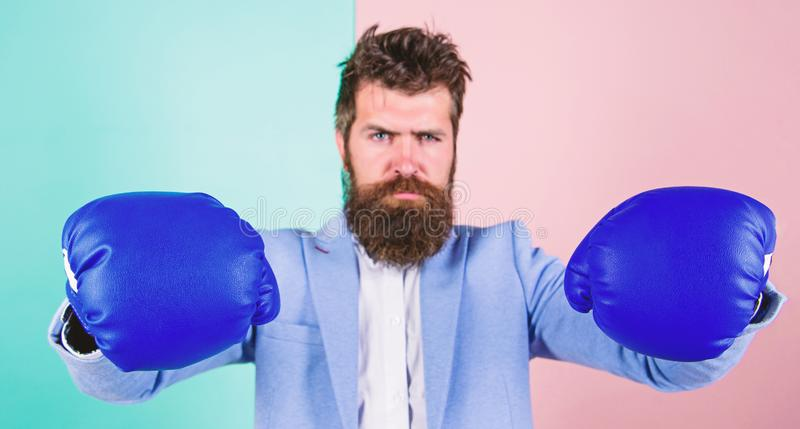 Strong and powerful. Bearded man in boxing stance. Fighting for success in sport and business. Businessman in formal. Wear and boxing gloves. Sport improves his royalty free stock photo