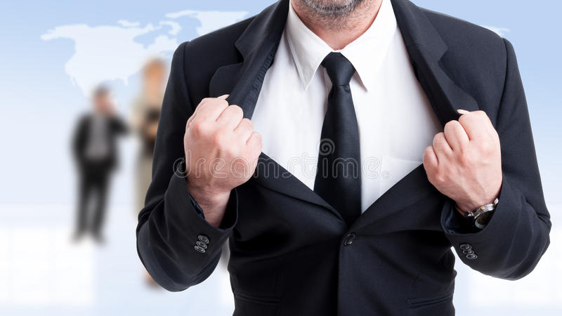 Strong and powerful business man concept. On business people background stock photography