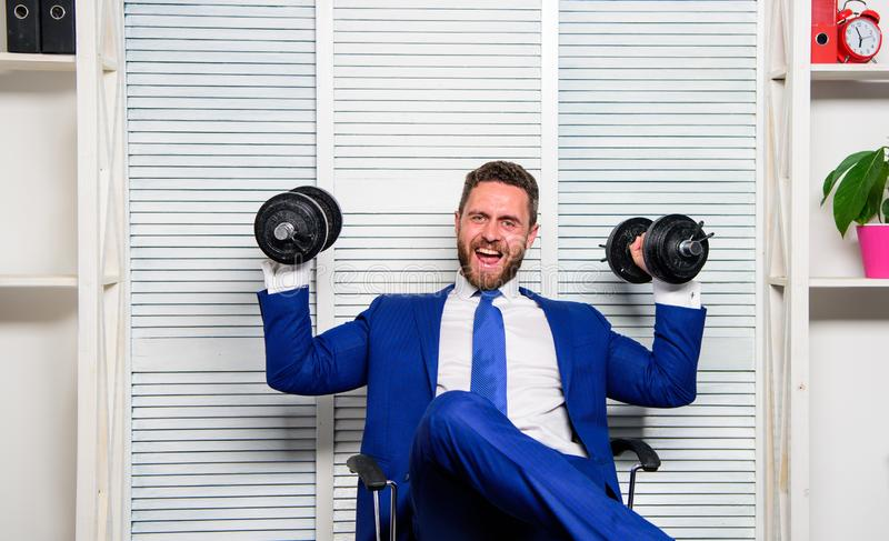 Strong powerful business strategy. Man raise heavy dumbbells. Boss businessman manager raise hands with dumbbells. Sport. Healthy lifestyle. Successful in sport stock photos
