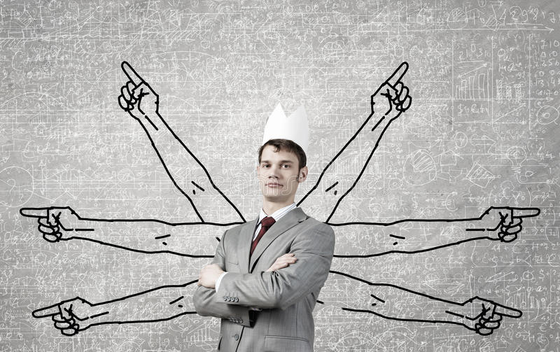 Strong and powerful. Young man with many drawn hands behind back stock images