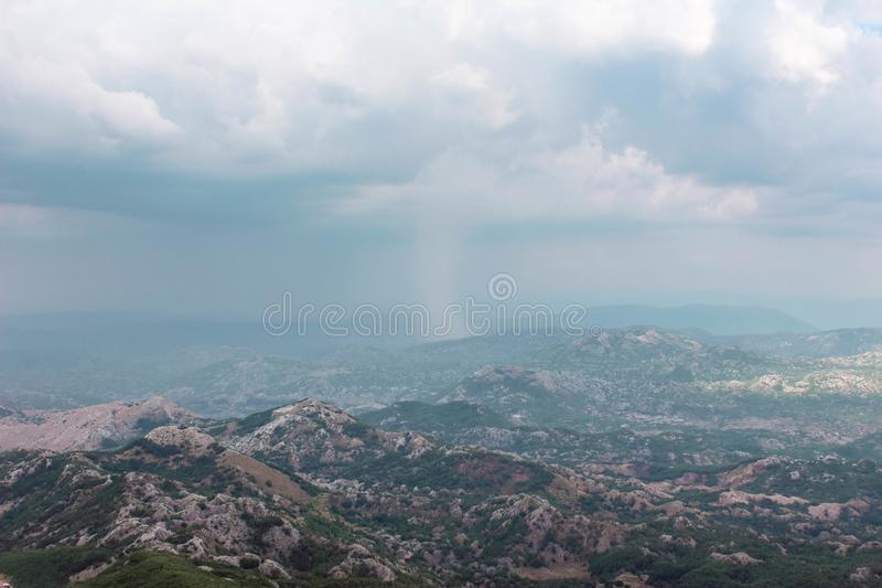 Strong rain in the mountain in Montenegro. This view from Lovchen mountain royalty free stock image