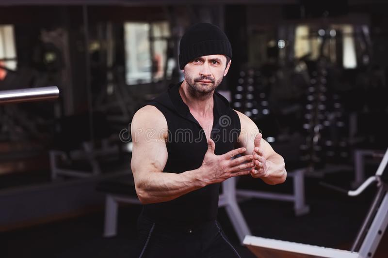 Strong ripped adult man with perfect abs, shoulders, biceps, tri stock photo