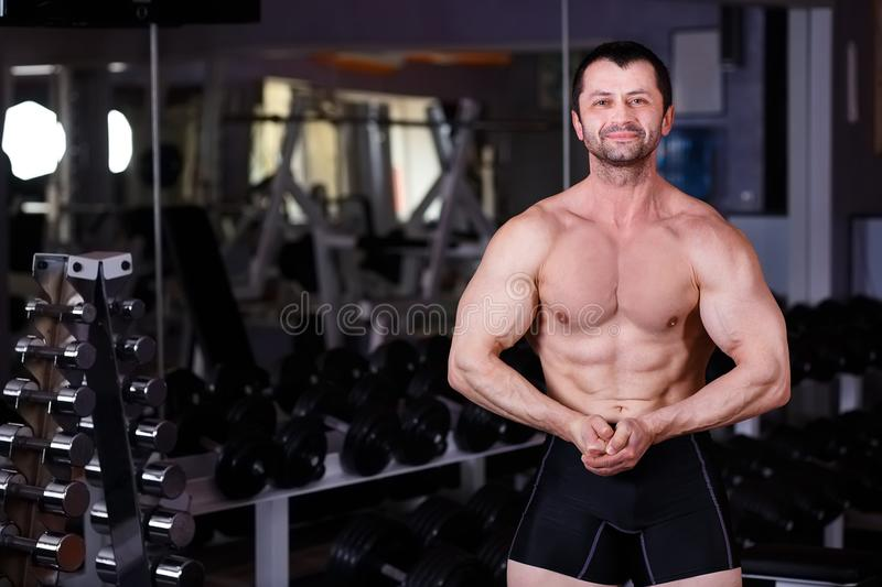 Strong ripped adult man with perfect abs, shoulders, biceps, tri stock image