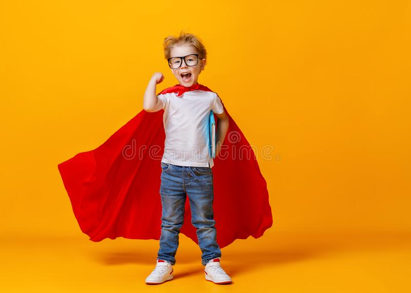 Happy smart superhero showing bicep royalty free stock photography