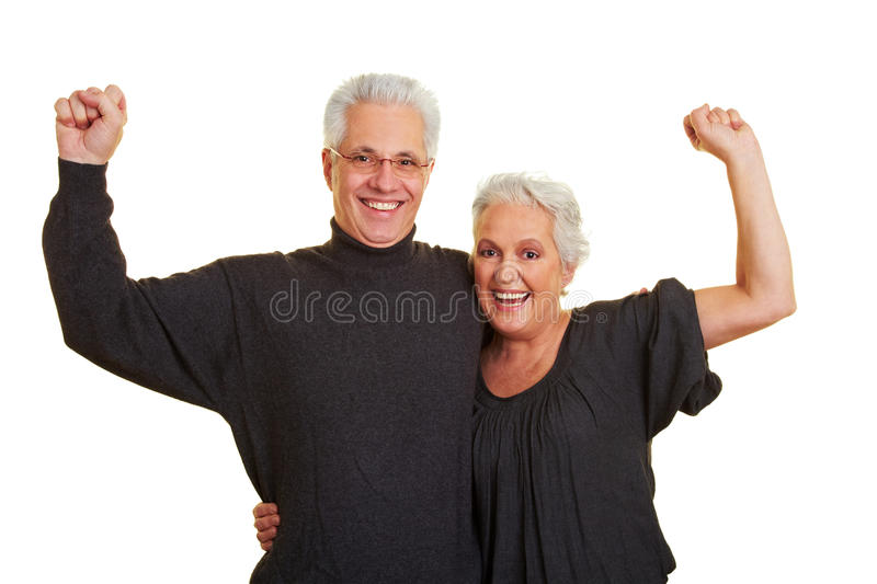 Strong senior citizens team. Two happy senior citizens clenching their fists royalty free stock photos