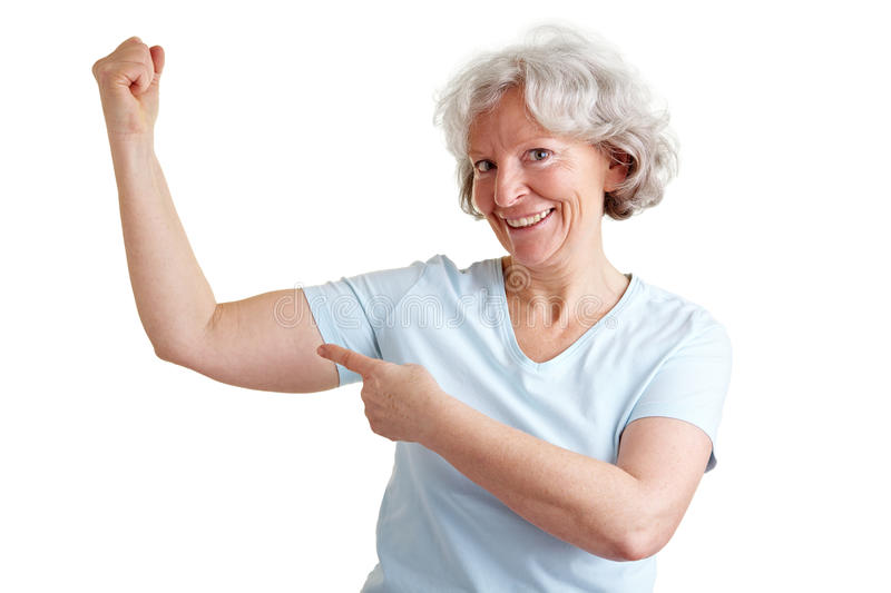 Strong senior woman doing fitness royalty free stock photo