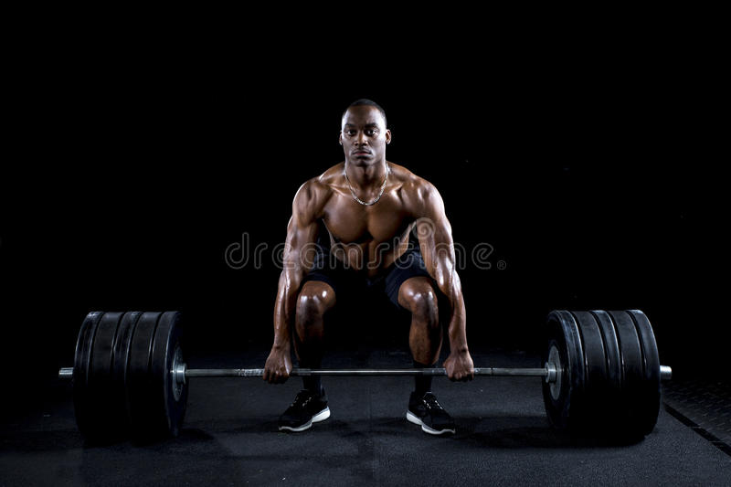 Strong man deadlifts a lot of weight royalty free stock photography