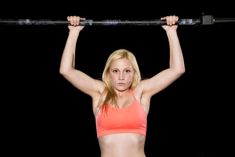Strong Woman Does A Pull Up Stock Photo
