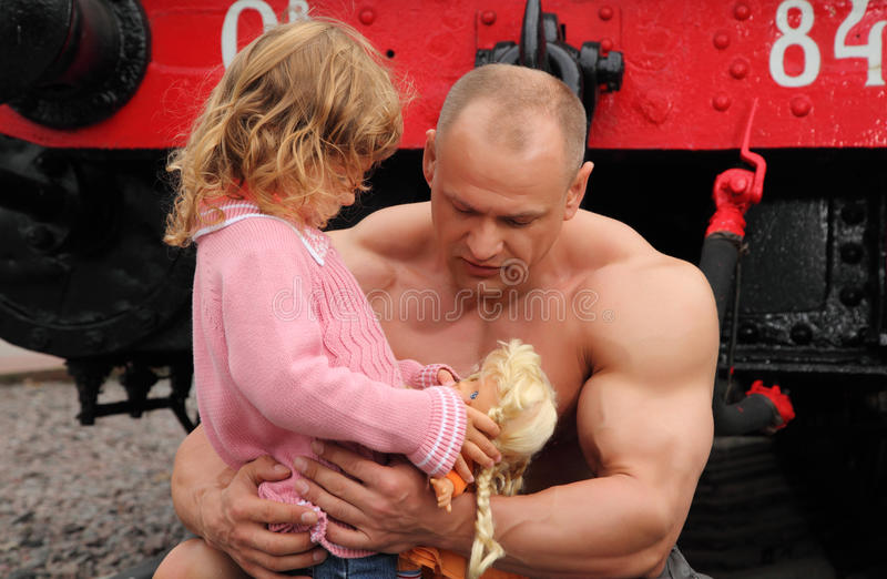Strong Shirtless Man Stands On Railroad With Girl Stock