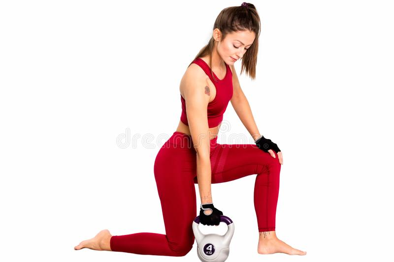 Strong slim girl with kettlebell. Strength and motivation. hobby, lifestyle - Image. Sportswoman working out with kettlebell. Photo Charming beautiful sport girl royalty free stock photo