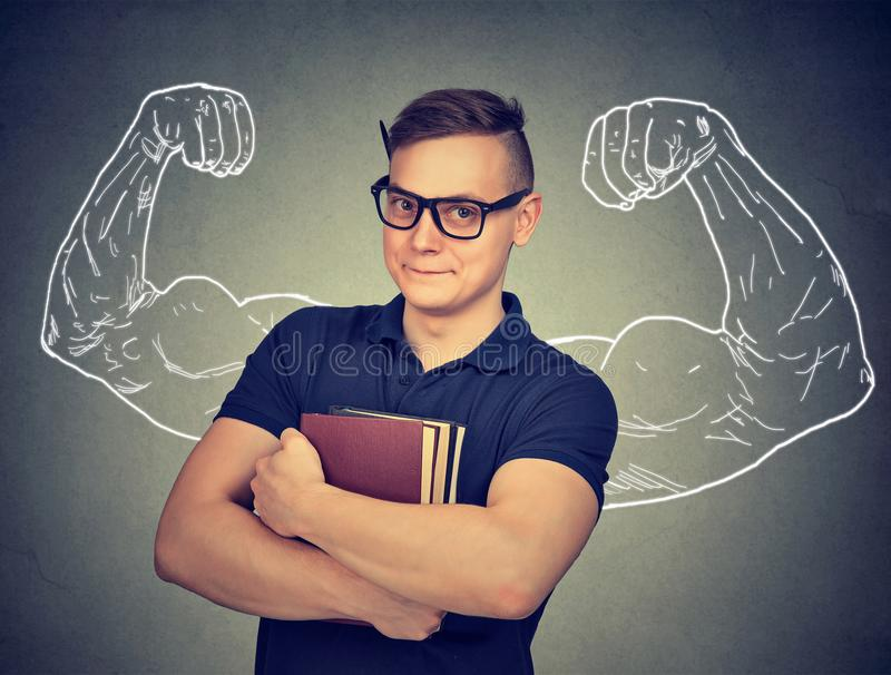 Strong nerd man with books stock photos