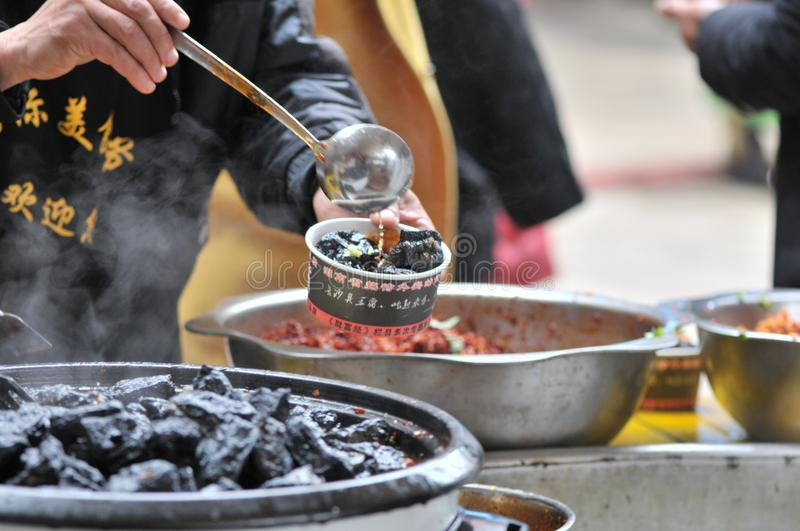 Strong-smelling preserved bean curd/fermented bean curd with smell/bean curd with odor. On festival gourmet festival which is prevalent Chinese delicacy royalty free stock photo