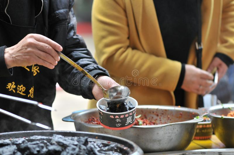 Strong-smelling preserved bean curd/fermented bean curd with smell/bean curd with odor. On festival gourmet festival which is prevalent Chinese delicacy stock image