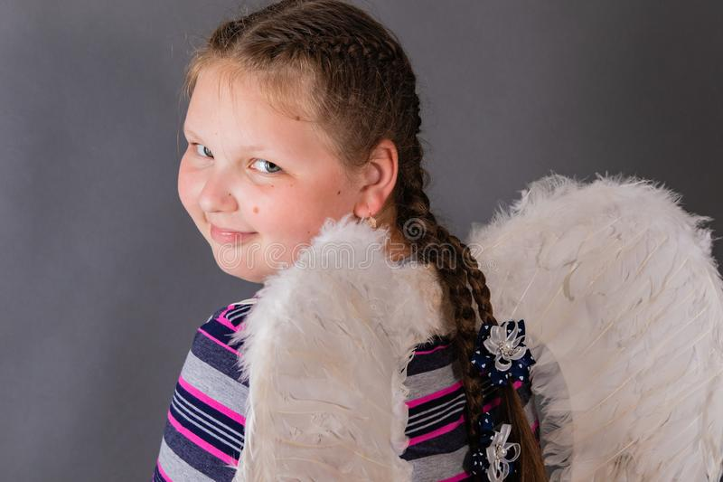 Strong smiling angel girl with wings royalty free stock photography