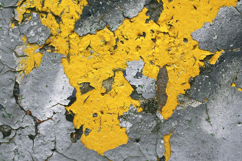 Strong surface structure with rest of yellow paint on concrete wall for abstract backgrounds. stock photo