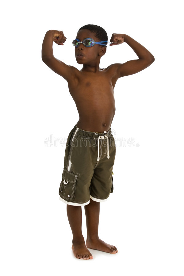 Strong Swimmer. A young African American boy wearing swim trunks and goggles, and showing his muscles. Isolated on a white background stock image