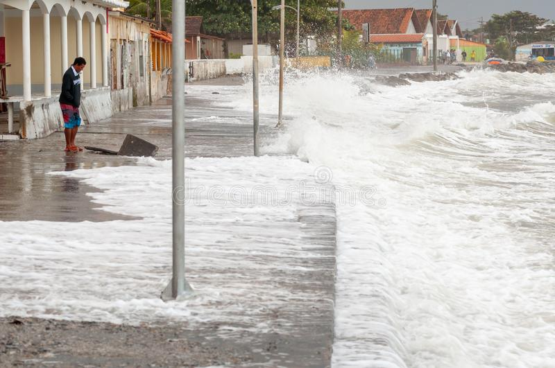 Strong waves hit the streets. Matinhos, Parana, Brazil - June 4, 2011: strong waves hit the streets of the neighborhood known as PICO, in the city of Matinhos royalty free stock photos