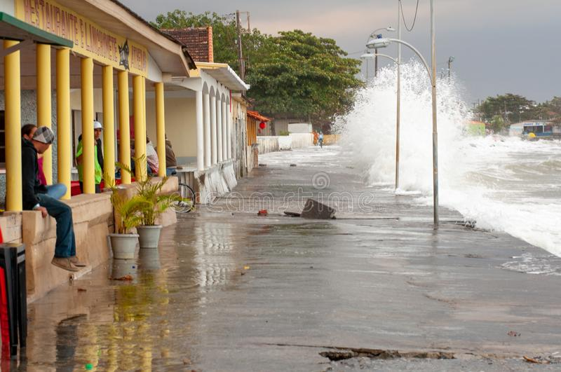 Strong waves hit the streets. Matinhos, Parana, Brazil - June 4, 2011: strong waves hit the streets of the neighborhood known as PICO, in the city of Matinhos stock photography