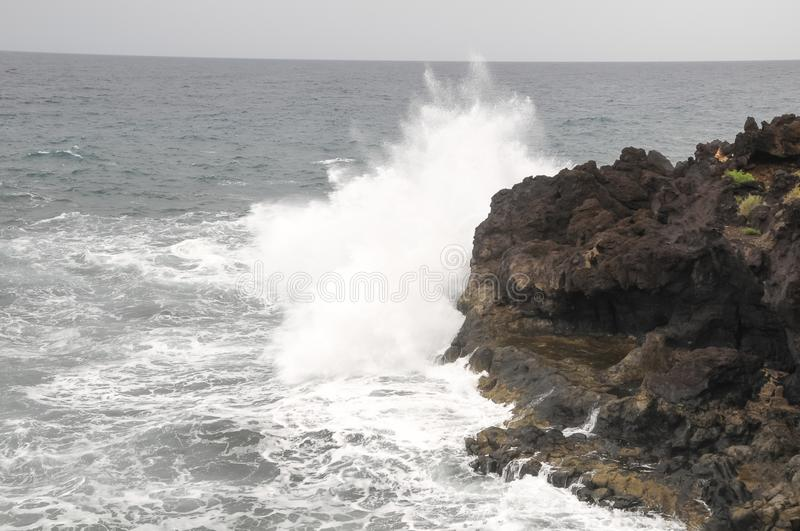 Strong Waves. Crashing on the Volcanic Coast in Tenerife Canary Islands royalty free stock photo