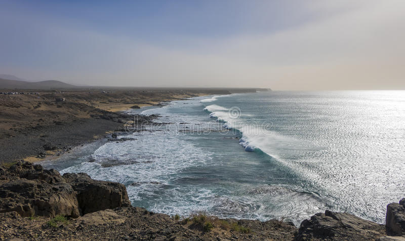 Strong waves on the surfing beach in El Cotillo Fuerteventura La. Strong waves on the surfing beach with dramatic lighting in El Cotillo Fuerteventura Las Palmas stock photo