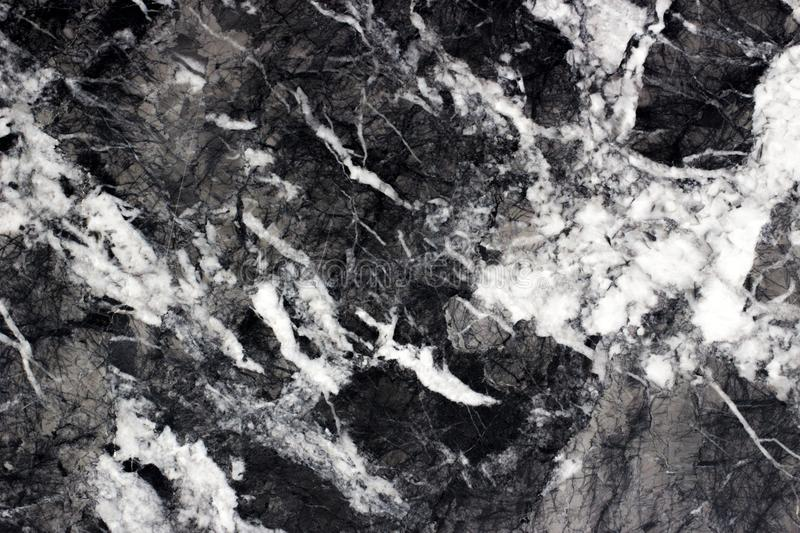 Strong white cracked line structure on Marquina black marble royalty free stock photography