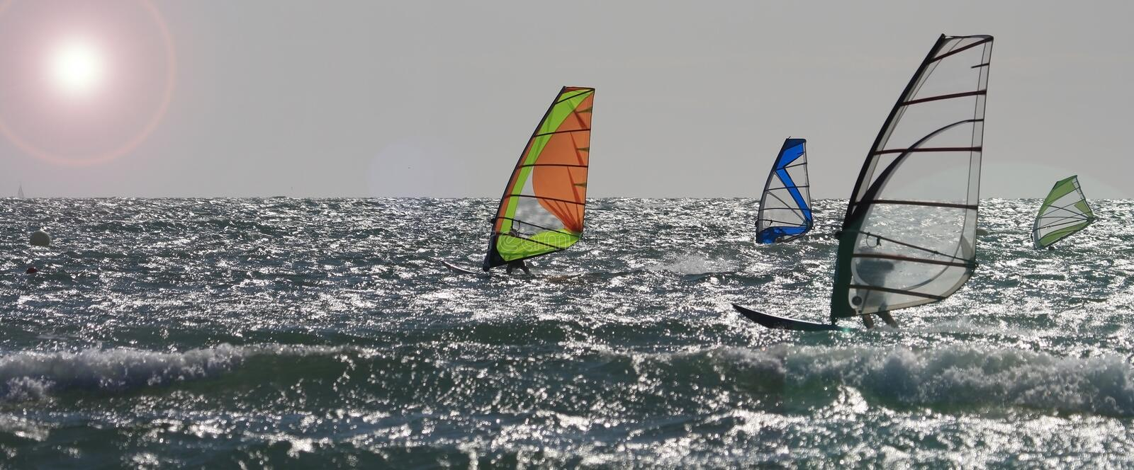Download Strong winds at Rhosneiger stock image. Image of windsurfer - 15012823