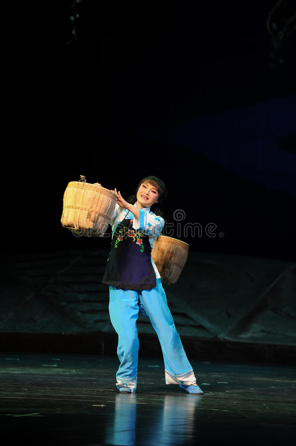 Strong woman is carrying a heavy burden- Jiangxi opera a steelyard. Jiangxi opera a steelyard is adapted from a true story: the last century fortys, the royalty free stock images