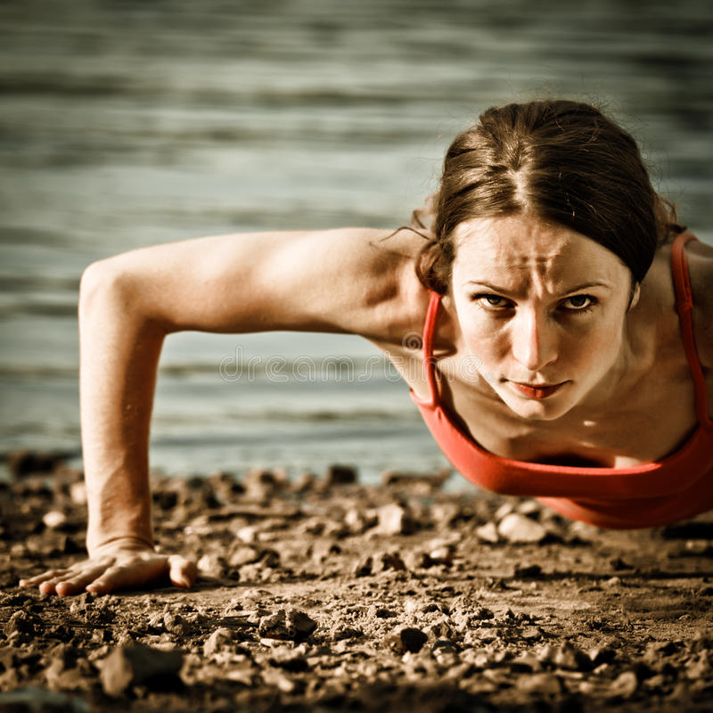 Free Strong Woman Doing Pushup Royalty Free Stock Photo - 22776235