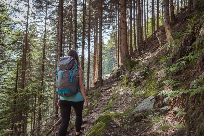 Strong woman hiking in the mountains stock photos