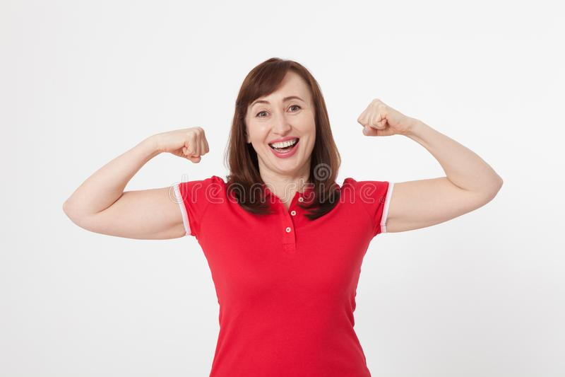 Strong woman showing her muscularity and looking at camera isolated on white. Copy space and blank shirt. Mother day stock image