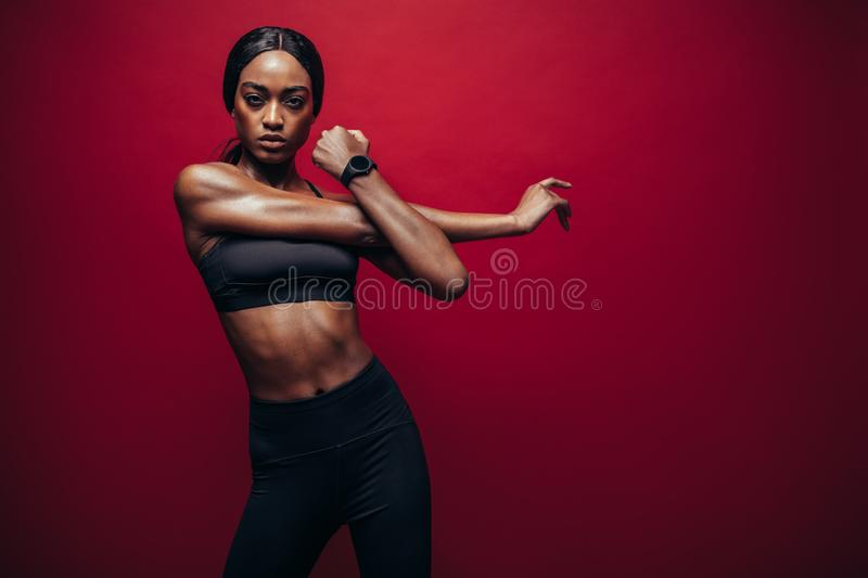 Strong woman stretching her arms stock photo