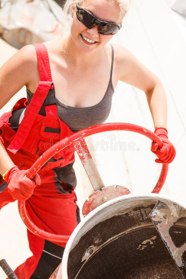 Strong woman working with construction site royalty free stock image