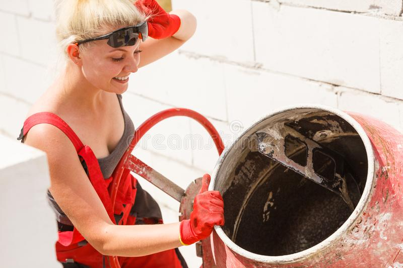 Strong woman working with construction site royalty free stock photography