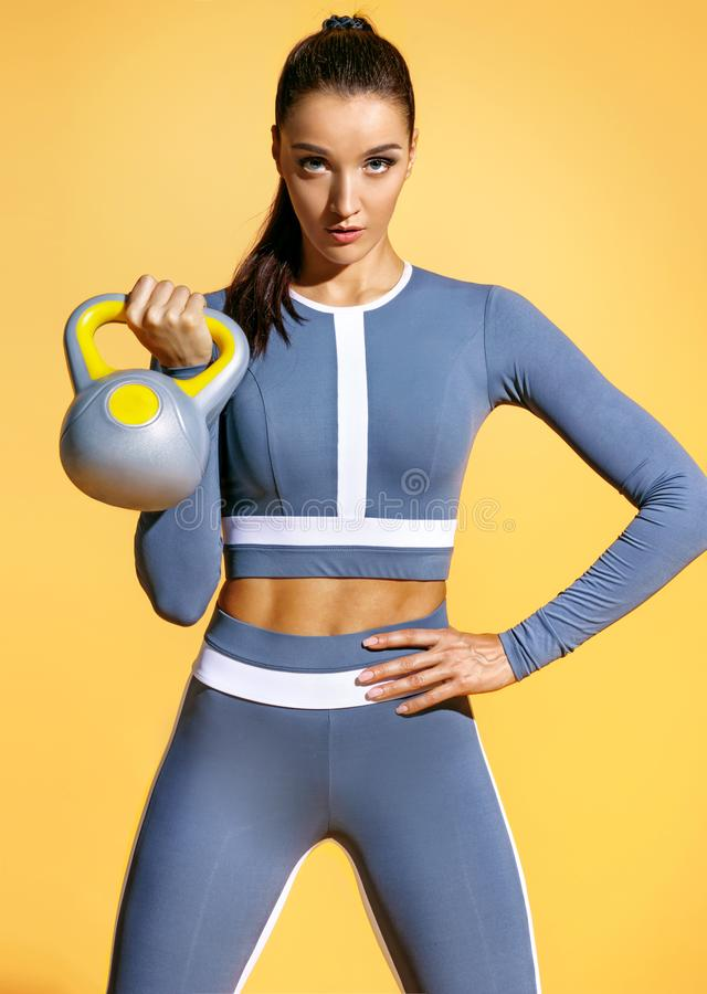 Strong woman workout with kettlebell. royalty free stock photography