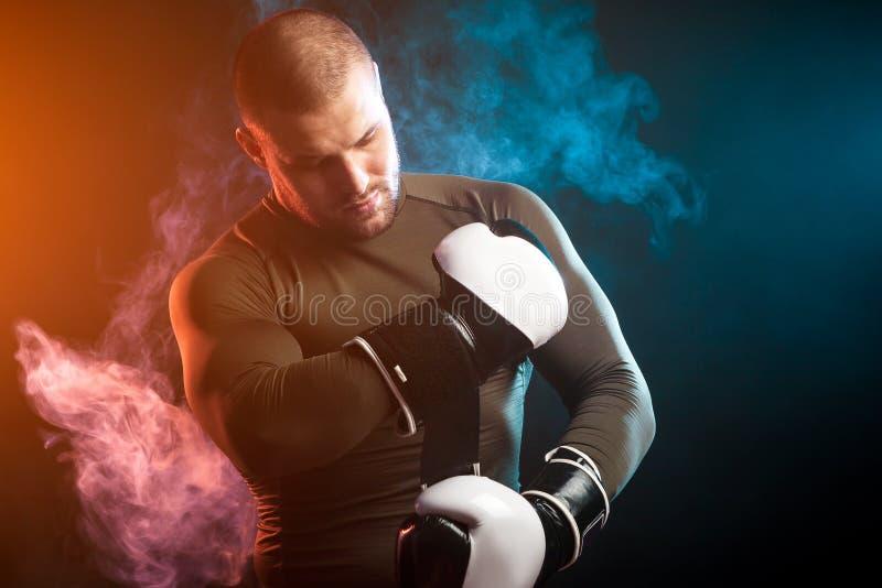 Athlete posing against smoke royalty free stock image