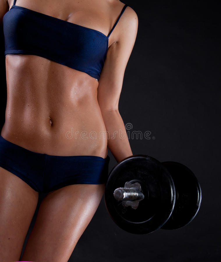 Download Strong Young Girl Working Out With Dumbbells. Stock Photo - Image: 19959290