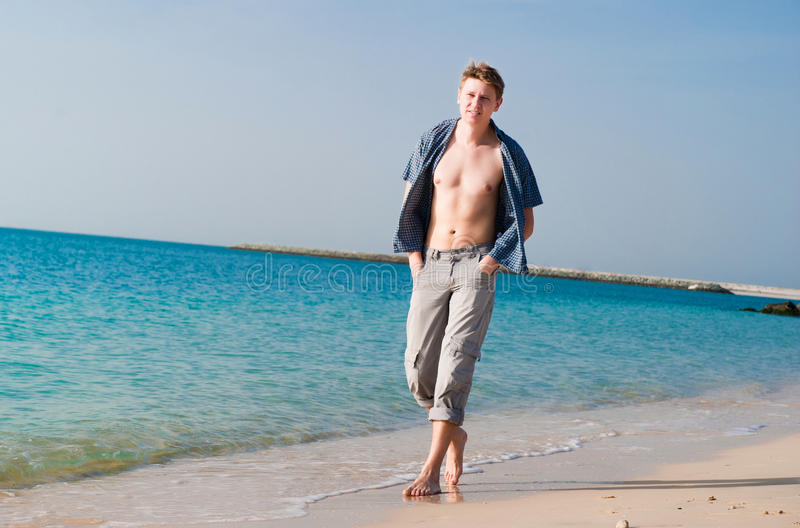 Download Strong young man at beach stock photo. Image of funny - 24704842