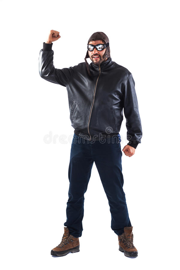 Strong young man dressed as a pilot royalty free stock images