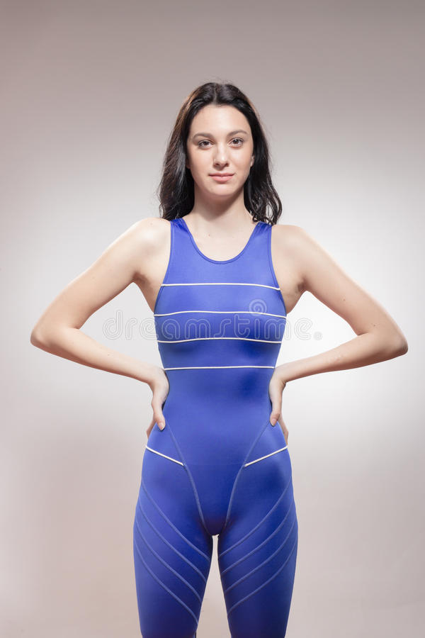 Strong young woman swimmer swimsuit stock image